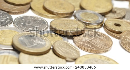Gold and Silver Foreign Coins and Currency, Money on White Background - stock photo