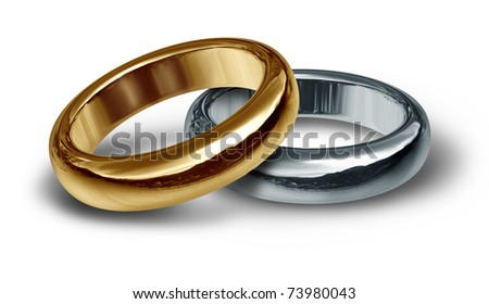 Gold and silver wedding rings resting on an isolated background representing the start of a new life and relationship.. - stock photo
