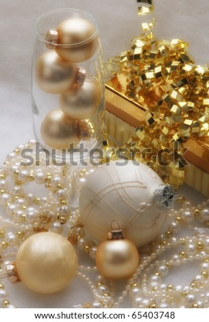 Gold and white trinkets, gift and holiday baubles - stock photo