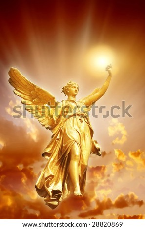 gold angel with divine Light over beautiful mystical sky - stock photo