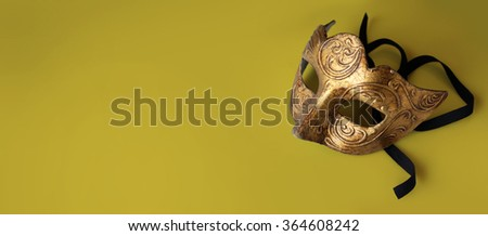 Gold background with Venetian mask for Carnival - stock photo