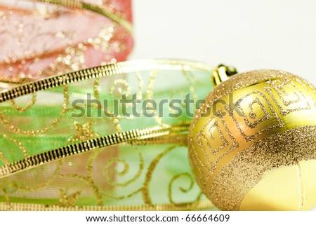 gold ball and Christmas ribbon around her