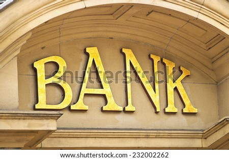 Gold Bank sign at the entrance to a Banking institute in the centre of the financial sector. - stock photo