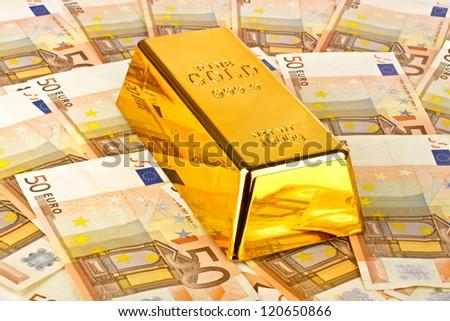 Gold bar and euro money - stock photo