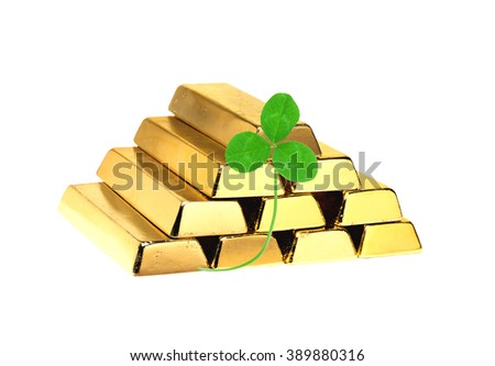 Gold Bars and clover leaf isolated on white background - stock photo
