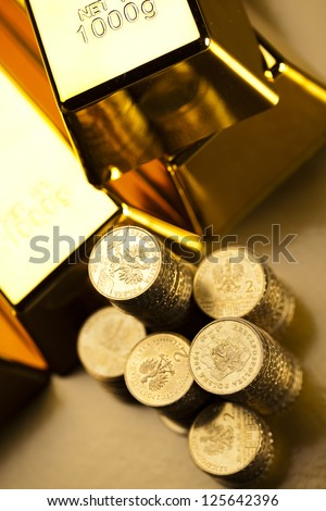 Gold bars and coins - stock photo