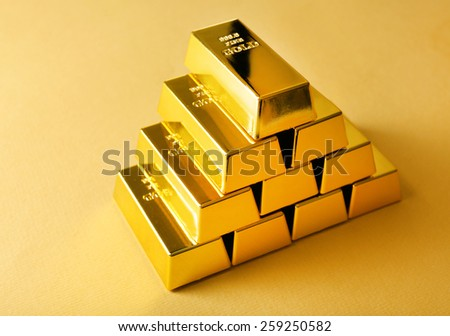 Gold bars on table close-up - stock photo
