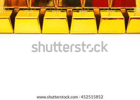 gold bars stacked up on top on a white background with copy space - stock photo