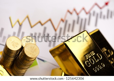 Gold bars with a linear graph - stock photo