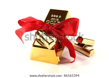 Gold bars with red bow on a white background - stock photo