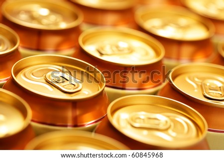 Gold beer cans close up. Shallow DOF! - stock photo
