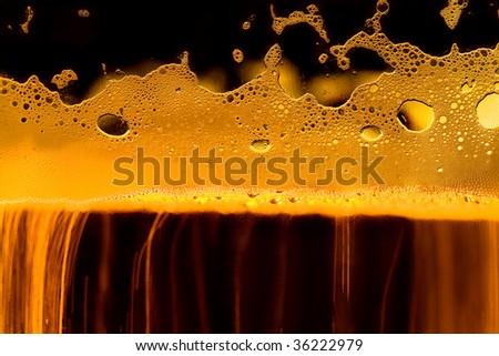 Gold beer texture. Macro image - stock photo