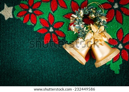 gold bells on christmas carpet , use for background - stock photo