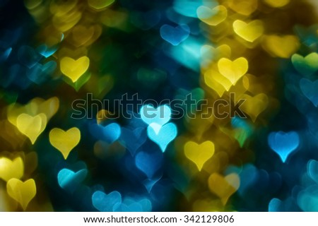 Gold, blue, dark heart bokeh background - stock photo