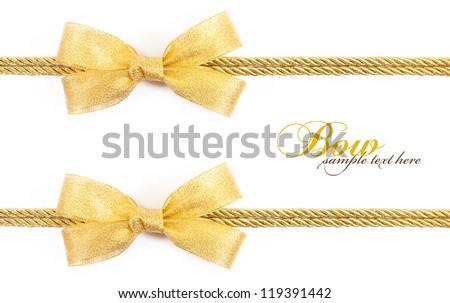 gold bow isolated on white background - stock photo