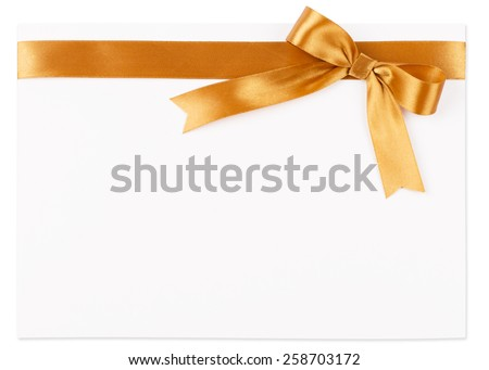 Gold bow on a satin ribbon on a white background - stock photo