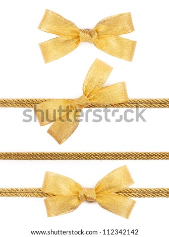Gold bow on the ribbon isolated on white background - stock photo