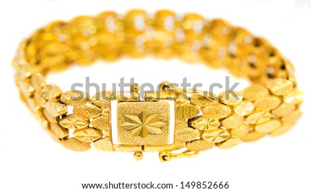 Gold bracelet over white background - stock photo