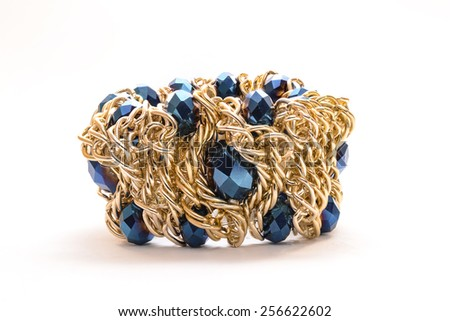 gold bracelet with diamonds on a white background - stock photo