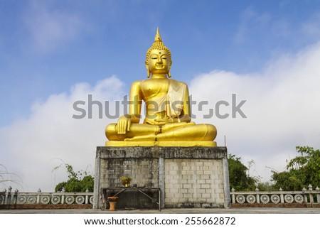 Gold buddha sit outdoor at Wat Som Det Temple, Sangkhla Buri, Kanchanaburi Province , Thailand - stock photo