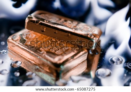 gold bullion and  flame. concept. safe investments. - stock photo
