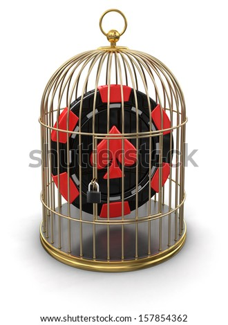 Gold Cage with Casino chip (clipping path included) - stock photo