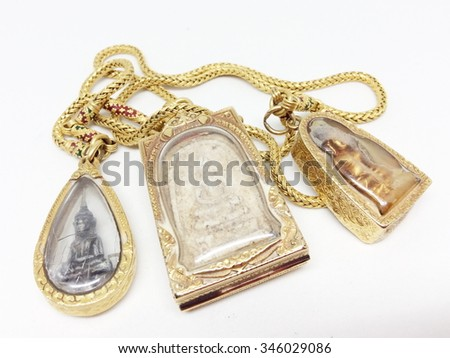 Gold chain with Buddha image isolated on white, closeup