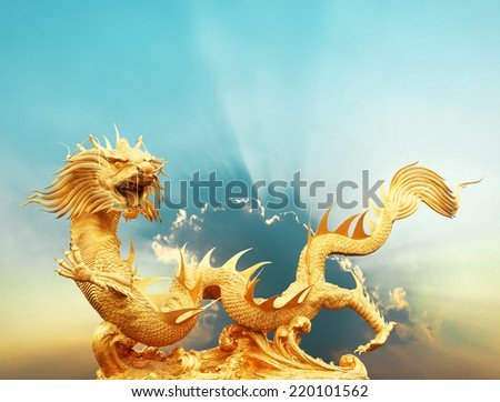 Gold chinese dragon statue with cloud and sky background, clipping path. - stock photo