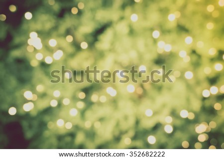 Gold Christmas background of de-focused lights with decorated tree, Christmas background