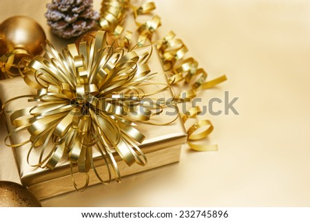 Gold Christmas background with gift and decorations - stock photo