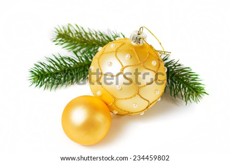 Gold Christmas balls and green branch on white background - stock photo
