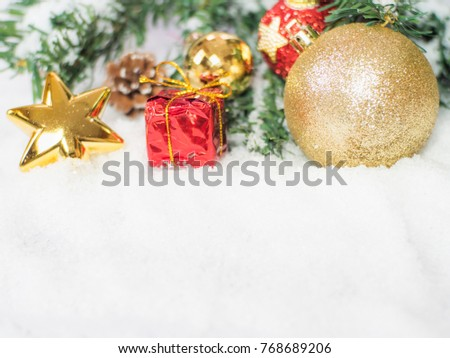 Gold christmas balls and star and red box in the snow. Copy and paste for background,  Concept decoration of christmas