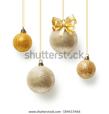 Gold christmas balls decorated with bow ribbon, collection on white background - stock photo