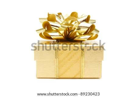Gold Christmas gift box with bow and ribbon over a white background - stock photo