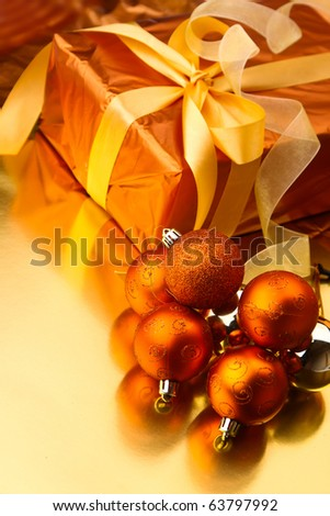 Gold Christmas gift box with christmas balls - stock photo