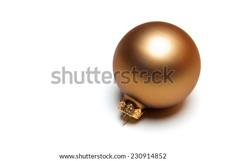 Gold christmas holiday ornament on a white background - stock photo