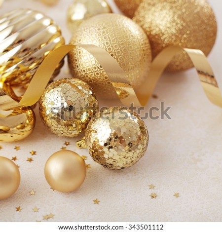 gold christmas ornaments, seasonal decoration - stock photo