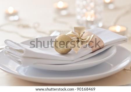Gold Christmas table setting - stock photo