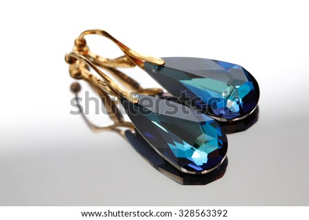 gold clips earrings with blue crystal