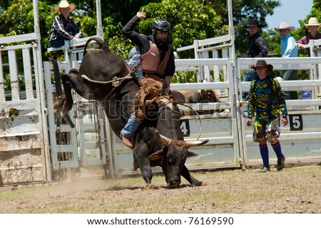 GOLD COAST, AUSTRALIA - JANUARY 26: Unidentified cowboy run away from dangerous bull on January 26,2011 in Gold Coast, Queensland, Australia. The rodeo show was part of Australia Day celebration