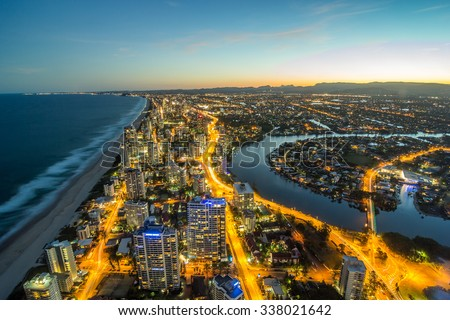 Gold Coast Beautiful Panorama Aerial view of Surfers Paradise City Skyline Cityscape with Light Trails from Q1 Building at dusk in summer Sunset, Australia - stock photo