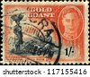 GOLD COAST - CIRCA 1952: A stamp printed in Gold Coast shows Queen Elizabeth and Breaking Cocoa Pods, circa 1952 - stock photo