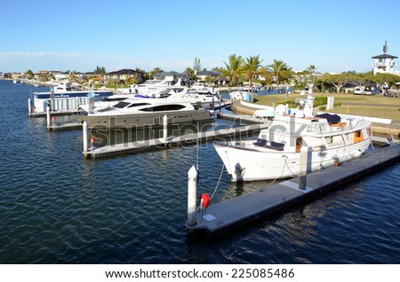 GOLD COAST - OCT 14 2014:Luxury homes and super yachts in Sovereign Islands.It's one of the most expensive areas in Gold Coast Queensland and Australia with some homes in excess of 20 million dollars. - stock photo