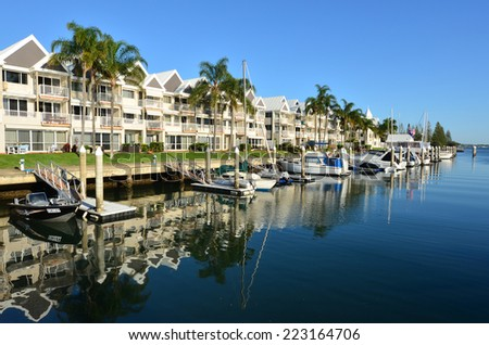 GOLD COAST - SEP 30 2014:Boats moor in Runaway Bay Marina.With 9 times more waterways than Venice, the Gold Coast is a boating paradise with over 260 kilometres of navigable waterways within the city. - stock photo