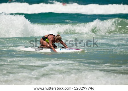 GOLD COAST, SURFERS PARADISE, QLD,  AUSTRALIA - FEB 9. 2013: An athlete  competes in the boarding stage on the round four of the Surf Ironwoman Series on February 09th 2013, Gold Coast Australia. - stock photo