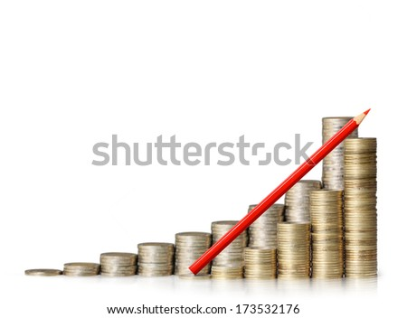 Gold coins and pencil stacked as a graph.