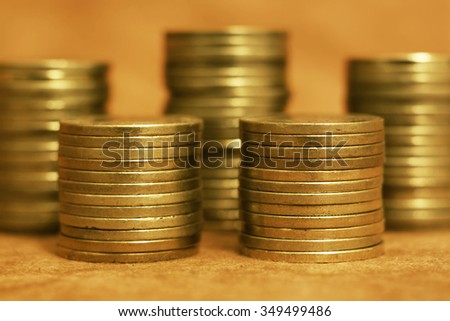Gold coins close up - wealth concept - stock photo
