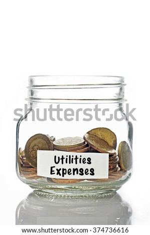 Gold coins in jar with Utilities Expenses isolated in white background - stock photo