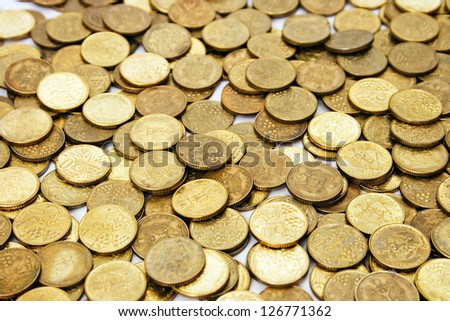 Gold coins on the table evenly. background texture. - stock photo