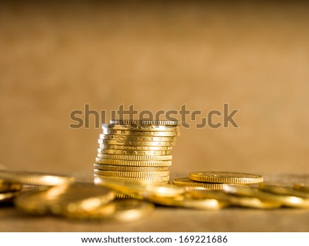 Gold coins over brown background